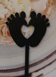 Kakkukoristetikku varpaat sydämellä musta